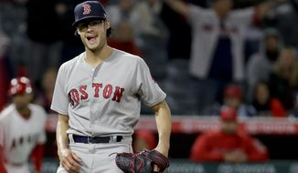 Boston Red Sox pitcher Joe Kelly celebrates the team's 8-2 win over the Los Angeles Angels in a baseball game in Anaheim, Calif., Thursday, April 19, 2018. (AP Photo/Chris Carlson)