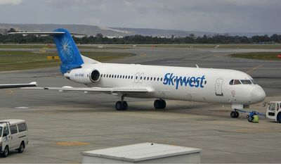 A Skywest Airlines Fokker 100 at Perth Airport is shown in this photo by Darren Koch via Wikimedia Commons (Darren Koch/Wikimedia)