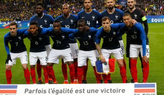 In this photo taken on Friday March 23, 2018 the French national soccer team poses before a friendly soccer match between France and Colombia in Saint-Denis, outside Paris. (AP Photo/Michel Euler)