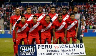 In this photo taken on Tuesday, March 27, 2018The Peru starting squad poses for a photo prior prior to an international friendly soccer match, in Harrison, N.J. (AP Photo/Adam Hunger)