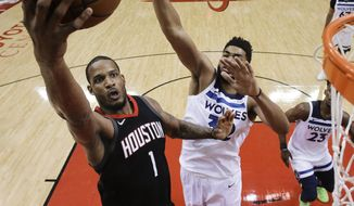 Houston Rockets forward Trevor Ariza (1) drives to the basket as Minnesota Timberwolves center Karl-Anthony Towns, right, defends during the first half in Game 5 of a first-round NBA basketball playoff series, Wednesday, April 25, 2018, in Houston. (AP Photo/Eric Christian Smith)