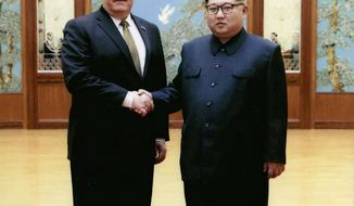 In this image released by the White House, then-CIA director Mike Pompeo shakes hands with North Korean leader Kim Jong Un in Pyongyang, North Korea, during a 2018 East weekend trip. President Donald Trump revealed more information about Pompeo's secret trip to North Korea, saying Pompeo wasn't supposed to meet with Kim, but that they ended up talking for more than an hour. Pompeo, who won Senate confirmation April 26, to become secretary of state, was the most senior U.S. official to meet a North Korean leader since 2000. (White House via AP)