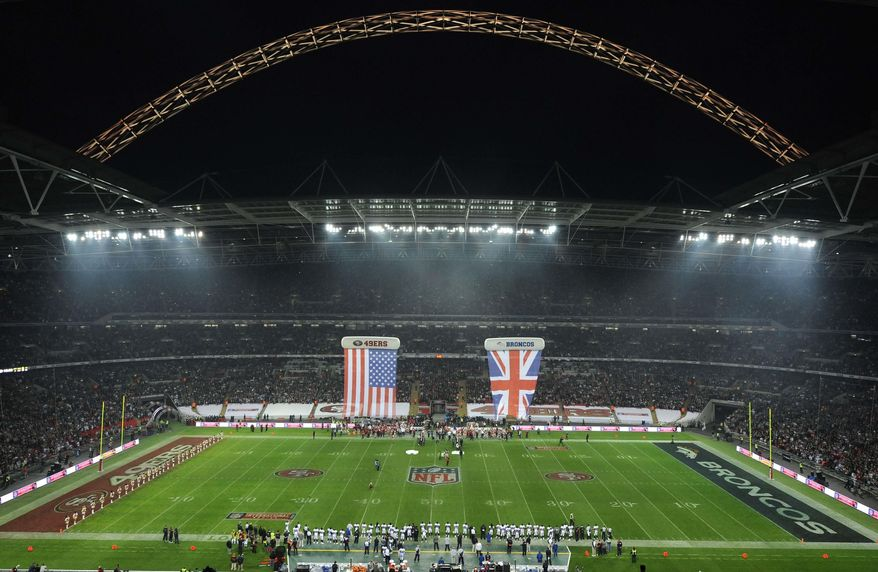 FILE - In this Sunday Oct. 31, 2010 file photo, the arena ahead of the NFL Football match between the Denver Broncos and San Francisco 49ers at Wembley Stadium in London. The English Football Association received an offer on Thursday April 26, 2018, to buy Wembley Stadium, from Jacksonville Jaguars and Fulham owner Shahid Khan. (AP Photo/Dave Shopland, Pool, File)