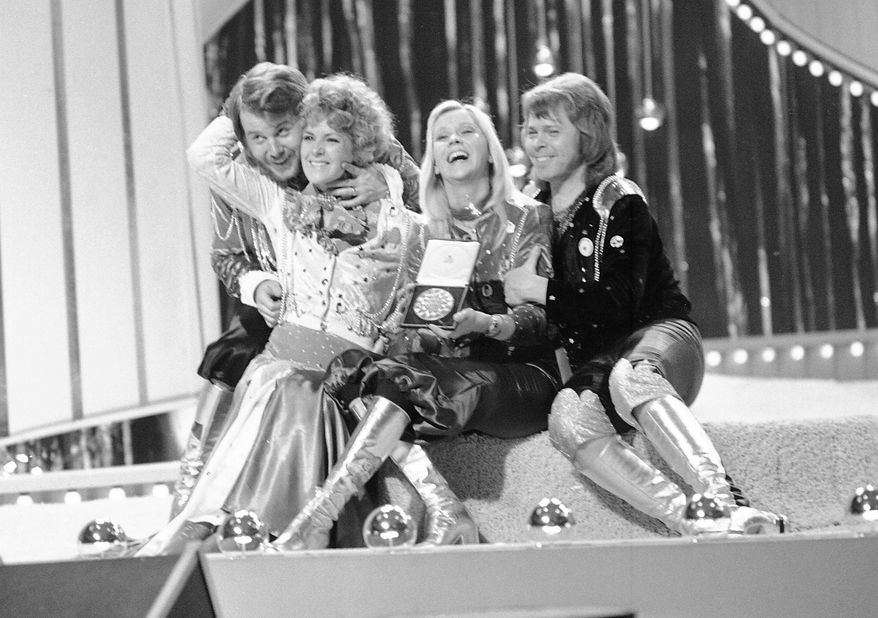 In this April 6, 1974 file photo, Swedish pop group ABBA celebrate winning the 1974 Eurovision Song Contest on stage at the Brighton Dome in England with their song Waterloo. From left, Benny Andersson, Anni-Frid Lyngstad (Frida), Agentha Faltskog, and Bjorn Ulvaeus. The members of ABBA announced on Friday April 27, 2018, they have recorded new material for the first time in 35 years. (AP Photo/Robert Dear, File)
