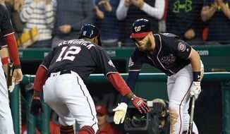 Washington Nationals' Howie Kendrick (12) celebrates his two-run home run with Bryce Harper during the third inning of a baseball game against the Arizona Diamondbacks, Friday, April 27, 2018, in Washington. (AP Photo/Nick Wass)