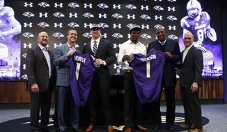 The Baltimore Ravens' first round draft picks, tight end Hayden Hurst, third from left, and quarterback Lamar Jackson, third from right, pose with Ravens director of college scouting Joe Hortiz, from left, head coach John Harbaugh, general manager Ozzie Newsome and assistant general manager Eric DeCosta during an NFL football news conference at the team's headquarters in Owings Mills, Md., Friday, April 27, 2018. (AP Photo/Patrick Semansky) **FILE**