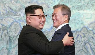 North Korean leader Kim Jong-un, left, and South Korean President Moon Jae-in embrace each other after signing on a joint statement at the border village of Panmunjom in the Demilitarized Zone, South Korea, Friday, April 27, 2018. (Korea Summit Press Pool via AP)