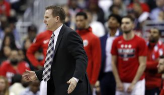 Washington Wizards head coach Scott Brooks reacts in the second half of Game 6 of an NBA basketball first-round playoff series against the Toronto Raptors, Friday, April 27, 2018, in Washington. The Raptors won 102-92. (AP Photo/Alex Brandon)