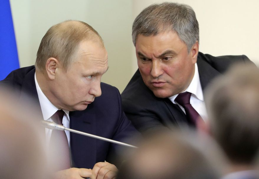 Russian President Vladimir Putin speaks with Parliament speaker Vyacheslav Volodin during his meeting with heads of Russian Parliament in St Petersburg, Russia, Friday, April 27, 2018. (Michael Klimentyev, Sputnik, Kremlin Pool Photo via AP)