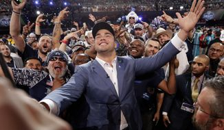 Texas' Connor Williams poses for a photo with Dallas Cowboys fans after being selected by the team during the second round of the NFL football draft Friday, April 27, 2018, in Arlington, Texas. (AP Photo/Eric Gay)