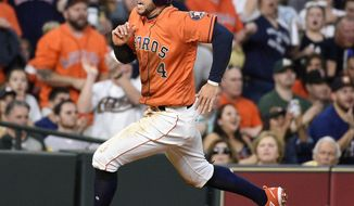 Houston Astros' George Springer rounds third to score on Carlos Correa's single during the fourth inning of a baseball game against the Oakland Athletics, Friday, April 27, 2018, in Houston. (AP Photo/Eric Christian Smith)