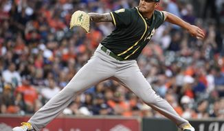 Oakland Athletics starting pitcher Sean Manaea delivers during the second inning of the team's baseball game against the Houston Astros, Friday, April 27, 2018, in Houston. (AP Photo/Eric Christian Smith)