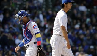 Chicago Cubs starting pitcher Yu Darvish, right, of Japan, and catcher Willson Contreras react after talking to each other on the field during the fifth inning of a baseball game against the Milwaukee Brewers, Friday, April 27, 2018, in Chicago. (AP Photo/Nam Y. Huh)