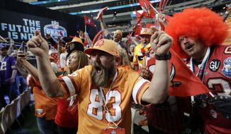 Tampa Bay Buccaneers fans cheer during the second round of the NFL football draft, Friday, April 27, 2018, in Arlington, Texas. (AP Photo/Eric Gay)