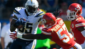 FILE - In this Sept. 24, 2017, file photo, Los Angeles Chargers tight end Antonio Gates, left, pushes aside Kansas City Chiefs linebacker Kevin Pierre-Louis during the first half of an NFL football game in Carson, Calif. Gates will not return for a 16th season with the Chargers, a person with knowledge of the decision tells The Associated Press. The person spoke on condition of anonymity Friday, April 27, 2018, because the Chargers have not publicly announced their plans for Gates. (AP Photo/Mark J. Terrill, File)