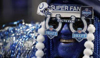 An Indianapolis Colts fan cheers during the second round of the NFL football draft, Friday, April 27, 2018, in Arlington, Texas. (AP Photo/Eric Gay)