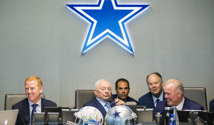 Dallas Cowboys owner Jerry Jones, center, coach Jason Garrett, left, CEO and Executive Vice President Stephen Jones, right, and other executives wait to make their first-round pick in the NFL football draft, Thursday, April 26, 2018, in Frisco, Texas. (Ashley Landis/The Dallas Morning News via AP)