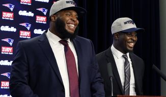 New England Patriots first-round NFL football draft picks, offensive lineman Isaiah Wynn, left, and running back Sony Michel, both out of the University of Georgia, laugh during a media availability, Friday, April 27, 2018, in Foxborough, Mass. (AP Photo/Bill Sikes)