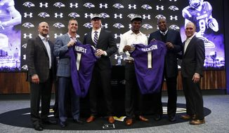 The Baltimore Ravens' first round draft picks, tight end Hayden Hurst, third from left, and quarterback Lamar Jackson, third from right, pose with Ravens director of college scouting Joe Hortiz, from left, head coach John Harbaugh, general manager Ozzie Newsome and assistant general manager Eric DeCosta during an NFL football news conference at the team's headquarters in Owings Mills, Md., Friday, April 27, 2018. (AP Photo/Patrick Semansky)