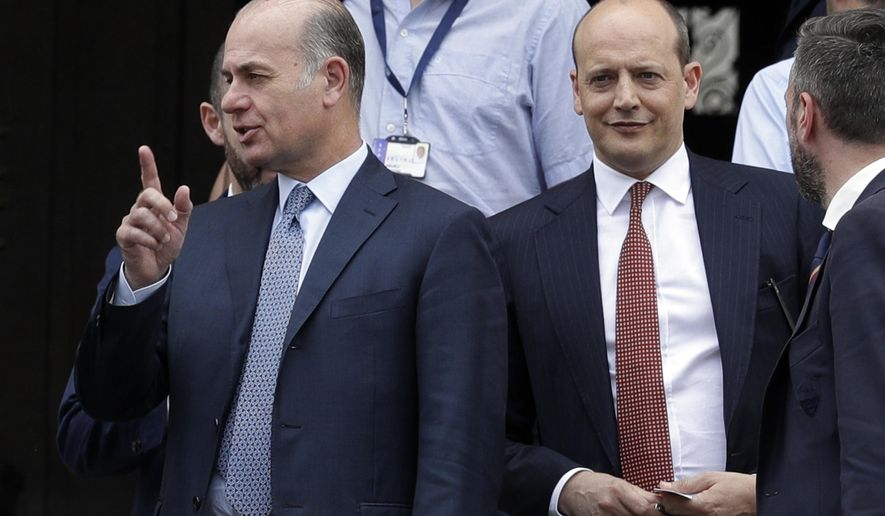 AS Roma CEO Umberto Gandini, left, and General Director Mauro Baldissoni, right, leave the Interior Ministry headquarters in Rome, Friday, April 27, 2018. Officials from Roma, Liverpool and UEFA met in Rome to discuss security concerns ahead of their Champions League return match next week.  (AP Photo/Andrew Medichini)