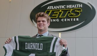 Sam Darnold poses for photos after a news conference introducing him as the New York Jets' selection from the first round of the NFL football draft, Friday, April 27, 2018, in Florham Park, N.J. (AP Photo/Julie Jacobson)