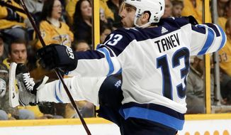 Winnipeg Jets left wing Brandon Tanev celebrates after scoring a goal against the Nashville Predators during the first period in Game 1 of an NHL hockey second-round playoff series Friday, April 27, 2018, in Nashville, Tenn. (AP Photo/Mark Humphrey)