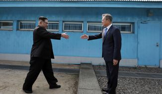 North Korean leader Kim Jong Un, left, prepares to shake hands with South Korean President Moon Jae-in at the border village of Panmunjom in Demilitarized Zone Friday, April 27, 2018. Their discussions will be expected to focus on whether the North can be persuaded to give up its nuclear bombs. (Korea Summit Press Pool via AP)