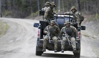 Maine state police patrol along Mill Stream Road in Norridgewock, Maine, Friday, April 27, 2018, during a manhunt for John Williams, wanted in the shooting death of Somerset County Sheriff's Deputy Eugene Cole on Wednesday. (Michael G. Seamans/The Central Maine Morning Sentinel via AP)