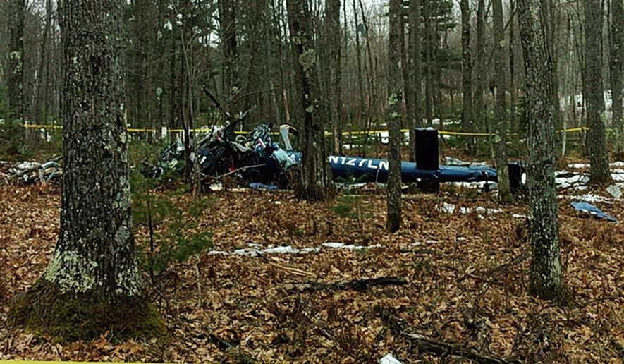 This image provided by the Oneida County Sheriff's Office in Rhinelander, Wis., shows the wreckage of a medical helicopter that was found early Friday, April 27, 2018, after it crashed in Hazelhurst, Wis. Authorities said the people aboard, all crew members, were killed. There were no patients on board. The last known contact with the helicopter was at 10:55 p.m. Thursday. (Oneida County Sheriff's Office via AP)