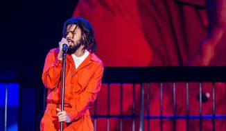 FILE - In this Sept. 7, 2017 file photo, J. Cole performs at The Budweiser Made In America Festival in Philadelphia.  The Platinum-selling rapper is honoring his home state by launching a music festival in North Carolina this September 2018. Dreamville Records and ScoreMore Shows announced Friday, April 27, 2018,  that the inaugural Dreamville Festival will debut Sept. 15 in Raleigh at Dorothea Dix Park.  Cole, who was born on a military base in Germany, was raised in Fayetteville, North Carolina.(Photo by Michael Zorn/Invision/AP) ** FILE **