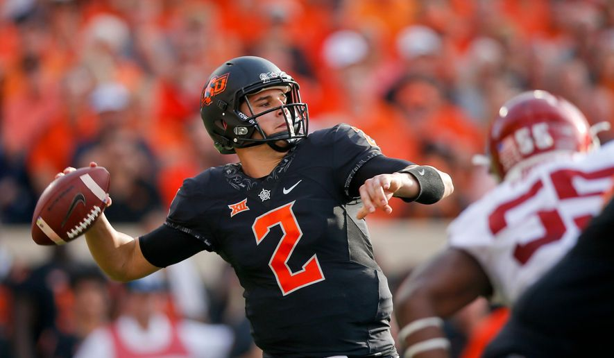 FILE - In this Nov. 4, 2017, file photo, Oklahoma State quarterback Mason Rudolph (2) attempts a pass during an NCAA football game against Oklahoma in Stillwater, Okla. Rudolph is expected to be taken in the NFL Draft. (Ian Maule/Tulsa World via AP, File)