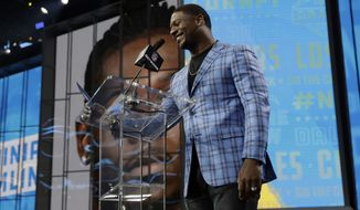 Former Chargers player LaDainian Tomlinson announces Southern California's Uchenna Nwosu as the Los Angeles Chargers' selection during the second round of the NFL football draft Friday, April 27, 2018, in Arlington, Texas. (AP Photo/Eric Gay)