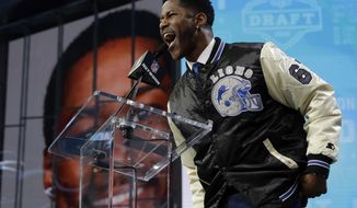 Former player Nate Burleson announces Auburn's Kerryon Johnson as the Detroit Lions' pick during the second round of the NFL football draft Friday, April 27, 2018, in Arlington, Texas. (AP Photo/Eric Gay)