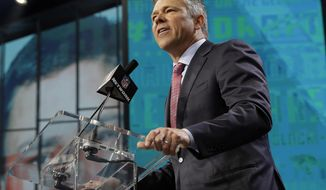 Former player Mark Brunell announces LSU's D.J. Chark as the Jackson Jaguars selection during the second round of the NFL football draft, Friday, April 27, 2018, in Arlington, Texas. (AP Photo/Eric Gay)