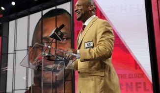 Pro Football Hall of Famer Aeneas Williams announces Texas A&M's Christian Kirk as the Arizona Cardinals' selection during the second round of the NFL football draft Friday, April 27, 2018, in Arlington, Texas. (AP Photo/Eric Gay)
