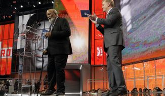 Pro Football Hall of Famer Jim Brown, left, announces Austin Corbett as the Cleveland Browns' selection during the second round of the draft, as NFL Commissioner Roger Goodell applauds, Friday, April 27, 2018, in Arlington, Texas. (AP Photo/Eric Gay)