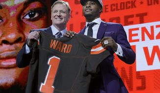 Ohio State's Denzel Ward, right, poses with Commissioner Roger Goodell after being selected by the Cleveland Browns during the first round of the NFL football draft, Thursday, April 26, 2018, in Arlington, Texas. (AP Photo/David J. Phillip)