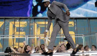 Iowa's Josh Jackson greets fans after Jackson was selected by the Green Bay Packers during the second round of the NFL football draft Friday, April 27, 2018, in Arlington, Texas. (AP Photo/Eric Gay)