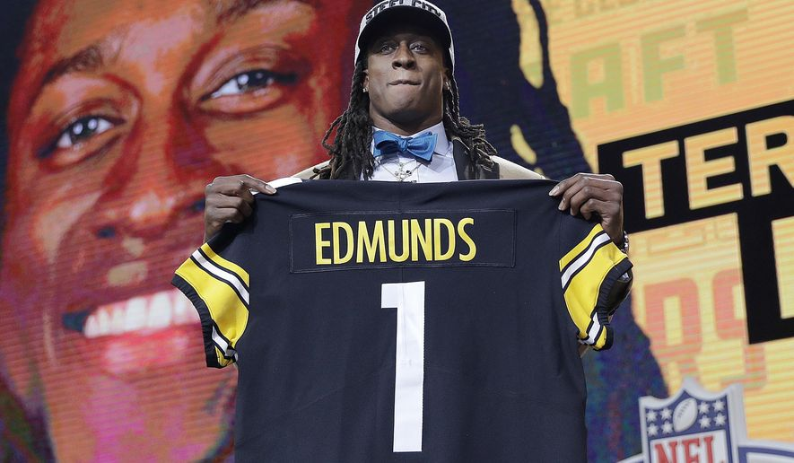 Virginia Tech's Terrell Edmunds poses with his Pittsburgh Steelers team jersey during the first round of the NFL football draft, Thursday, April 26, 2018, in Arlington, Texas. (AP Photo/David J. Phillip)