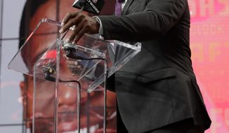 Former player Priest Holmes announces Mississippi's Breeland Speaks as the Kansas City Chiefs' selection during the second round of the NFL football draft Friday, April 27, 2018, in Arlington, Texas. (AP Photo/Eric Gay)