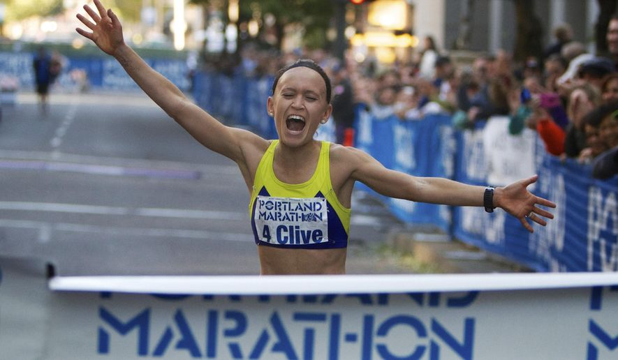 FILE--In this Oct. 7, 2012, file photo, Colleen Little, 29, of Lake Oswego, Ore., wins the women's division of the Portland Marathon in Portland, Ore. After a tumultuous 2017, there will be no 2018 for the Portland Marathon. In an open letter submitted to Mayor Ted Wheeler's office, the Portland Marathon board of directors announced Friday, April 27, 2018, that it had started the process of dissolving the organization. (Randy L. Rasmussen/The Oregonian/Oregon Live via AP, File)