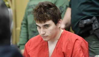 Florida school shooting suspect Nikolas Cruz, looks up while in court for a hearing in Fort Lauderdale, Fla., Friday, April 27, 2018. The hearing is expected to deal with several procedural issues possibly including setting an initial trial date. Cruz is charged with 17 counts of murder and 17 counts of attempted murder in the Feb. 14, 2018 school shooting at Marjory Stoneman Douglas High School in Parkland, Fla. (Taimy Alvarez/South Florida Sun-Sentinel via AP, Pool) ** FILE **