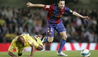"""FILE - In this Sunday, April 22, 2007 file photo Barcelona's Andres Iniesta from Spain, right, duels for the ball with Villarreal player Marcos Senna from Spain, left, during their Spanish league soccer match at the Madrigal Stadium in Villarreal, Spain. Andres Iniesta says that he will leave Barcelona this summer after 16 trophy-packed seasons with the Spanish club. Iniesta, who turns 34 on May 11, says Friday """"this season is the last."""" (AP Photo/Fernando Bustamante)"""