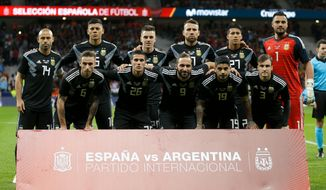 FILE - In this Tuesday, March 27, 2018 filer, Argentina's players line up for the team photo prior to the international friendly soccer match between Spain and Argentina at the Wanda Metropolitano stadium in Madrid. (AP Photo/Francisco Seco, File)