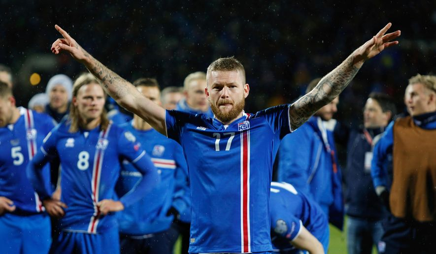 FILE - In this Monday Oct. 9, 2017 filer, Iceland's captain Aron Gunnarsson celebrates at the end of the World Cup Group I qualifying soccer match between Iceland and Kosovo in Reykjavik, Iceland. (AP Photo/Brynjar Gunnarsson, File )