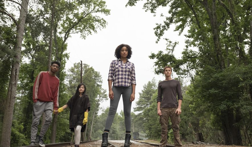 "This image released by 20th Century Fox shows, from left, Skylan Brooks, Miya Cech, Amandla Stenberg and Harris Dickinson in a scene from, ""The Darkest Minds."" The film, directed by Jennifer Yuh Nelson, is expected in theaters on August 3. (Daniel McFadden/20th Century Fox via AP)"