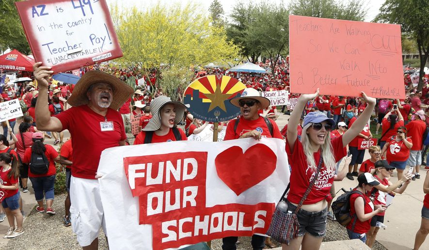 Thousands chant as they participate in a protest at the Arizona Capitol for higher teacher pay and school funding on the first day of a state-wide teachers strike Thursday, April 26, 2018, in Phoenix. (AP Photo/Ross D. Franklin)
