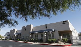 """Records obtained by The Associated Press show that a company controlled by Semyon """"Sam"""" Shtayner, a taxi magnate and longtime business associate of President Donald Trump's personal lawyer, has applied for a business license to run a legal medical marijuana cultivation and edible production facility out of this building, photographer April 25, 2018, in Henderson, Nev. Another, unrelated marijuana cultivation business is also located in the same building. Property records show Michael Cohen, whose personal business dealings are being investigated by federal authorities, and his father-in-law, have lent $26 million to Shtayner in recent years. (AP Photo/John Locher)"""