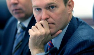 FILE - In this April 10, 2017, file photo, Salt Lake County Mayor Ben McAdams, right, listens during a committee hearing in Salt Lake City. Democrats in deep-red Utah are looking to McAdams to flip one of the state's four Republican-controlled congressional districts and help take control of the U.S. House. But first he has to win the party's nomination against four challengers at the party's state convention Saturday, April 28, 2018. (AP Photo/Rick Bowmer, File)