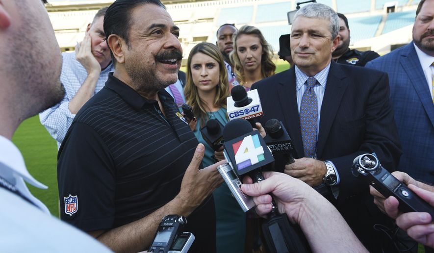 Jacksonville Jaguars owner Shad Khan, left, fields questions from the media on his interest in buying Wembley Stadium in London ahead of the Uniform Launch and Draft Party NFL football event at EverBank Field in Jacksonville, Fla., Thursday, April 26, 2018. The English Football Association has received an offer from Khan of about 600 million pounds ($840 million) for the national soccer stadium, which would continue to host England games and major cup finals after a sale. (Bob Self/The Florida Times-Union via AP)